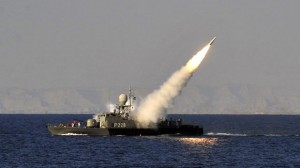 Jan. 1, 2012: In this image made available by the Iranian Students News Agency, an Iranian navy vessel launches a missile during a drill at the sea of Oman. (AP)
