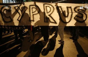 Anti-Troika protesters hold a &quot;Hands off Cyprus&quot; banner during a demonstration outside the EU offices in Nicosia March 24, 2013. REUTERS/Yannis Behrakis