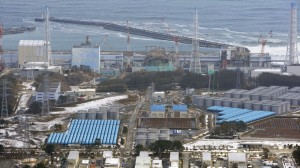 Cranes stand around tsunami-crippled four reactors, from left, Unit 1 to Unit 4, at Fukushima Dadi-ichi nuclear power plant in Okuma, Fukushima Prefecture, Japan Sunday, March 11, 2012. (AP /Kyodo News)