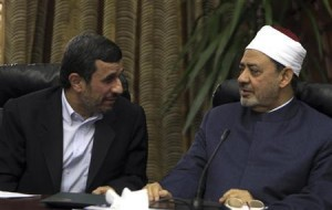 Iran's President Mahmoud Ahmadinejad speaks with Sheikh Ahmed al-Tayeb, Egypt's leading Sunni Muslim scholar at the historic al-Azhar mosque and university, in Cairo February 5, 2013. Mahmoud Ahmadinejad was both kissed and scolded on Tuesday when he began the first visit to Egypt by an Iranian president since Tehran's 1979 Islamic revolution. The trip was meant to underline a thaw in relations since Egyptians elected an Islamist head of state, President Mohamed Mursi, last June. But it also highlighted deep theological and geopolitical differences. REUTERS/Mohamed Abd El Ghany
