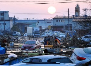 Residents searching through debris in tsunami-ravaged Sendai, Japan