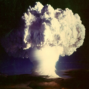 A mushroom cloud created by the detonation of a nuclear weapon.