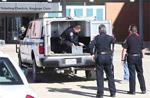 Explosive handlers on the scene at Midland Texas airport earlier today