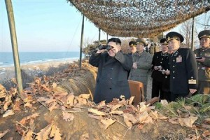 North Korean leader Kim Jong-Un (L) watches soldiers of the Korean People's Army (KPA) taking part in the landing and anti-landing drills of KPA Large Combined Units 324 and 287 and KPA Navy Combined Unit 597, in the eastern sector of the front and the east coastal area on March 25, 2013, in this picture released by the North's KCNA news agency in Pyongyang March 26, 2013. REUTERS/KCNA