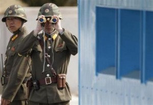 North Korean soldiers look to the South as they patrol at the truce village of Panmunjom in the demilitarised zone separating the North from South Korea in Paju, about 55 km (34 miles) north of Seoul March 19, 2013. REUTERS/Lee Jae-Won