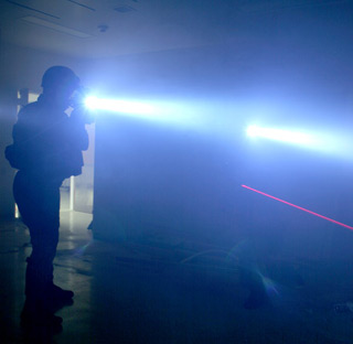 A tactical flashlight in use.