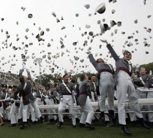 Cadets toss their hats in the air at the completion of a graduation ceremony at the United States Military Academy at West Point, N.Y.  (AP Photo/Mike Groll)